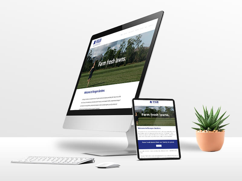Paragon Gardens website design on laptop