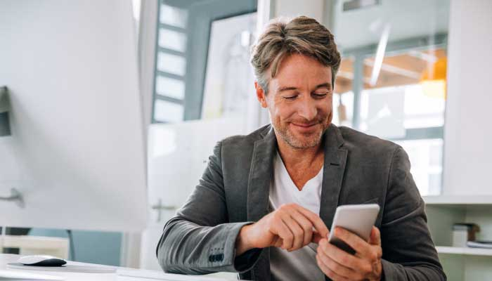 man using mobile to consumer marketing content grey and grey