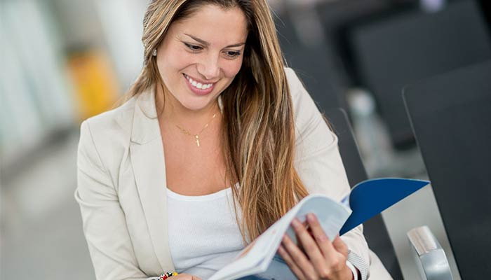 woman reading a brochure grey and grey marketing consultant brisbane townsville